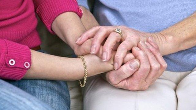 Carer comforting woman