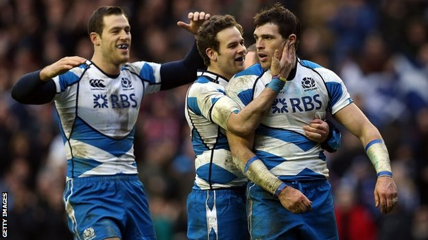 Sean Lamont (R) of Scotland celebrates scoring a try with Tim Visser (L) and Ruaridh Jackson