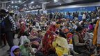 Passengers crowd together at a platform after a stampede at Allahabad railway station on February 10, 2013.