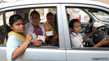 Drivers with Sakha in Delhi show their licences