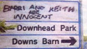 Road sign with graffiti 'Barri and Keith are innocent'