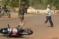A Malian soldier arrests a man at a checkpoint in Gao