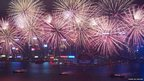 Fireworks explode over Victoria Harbour to celebrate the Chinese Lunar New Year in Hong Kong