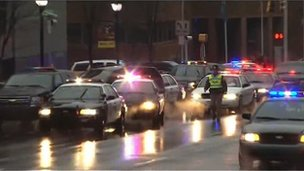 Police cars outside a courthouse in Wilmington, Delaware 11 February 2013