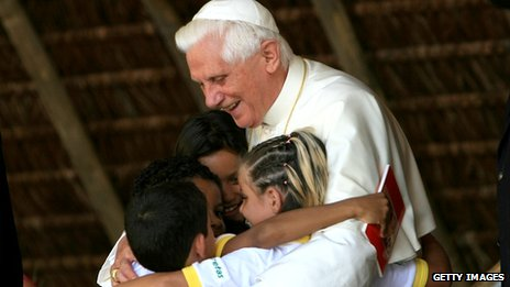 Pope Benedict embraces children during a visit to home for recovering drug addicts in Brazil, 12 May 2007