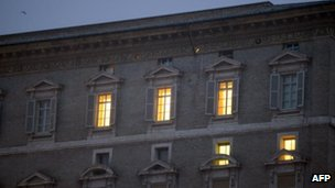 Lights shine from Pope Benedict apartments at the Vatican