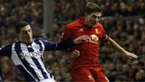 Liverpool's Steven Gerrard (right) is challenged by West Bromwich Albion's Graham Dorrans