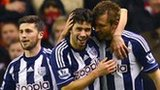 West Bromwich Albion's Irish defender Gareth McAuley (R) celebrates with teammates Argentine midfielder Claudio Yacob (C) and Irish forward Shane Long (L) after scoring the opening goal