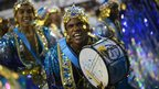 Members of the percussion section of the Beija-Flor samba school parade on Monday at the Rio carnival