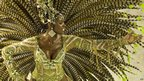 Member of Imperatriz Leopoldinense samba school performs on Monday night at the Rio carnival