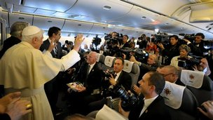 Pope Benedict XVI on a flight to Mexico in March 2012