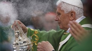 The Pope swings the censer during mass