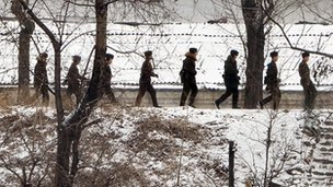 North Korean soldiers patrol along the Yalu River at the North Korean town of Sinuiju on February 12, 2013 across from the Chinese city of Dandong.