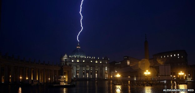 A flash of lighting is seen over St Peter&#039;s Basilica