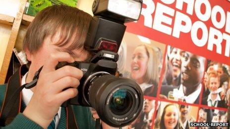 School Reporter taking photo