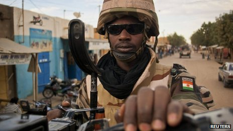 A Nigerian soldier rides atop an armoured vehicle during a patrol in the northern city of Gao, Mali - 9 February 2013