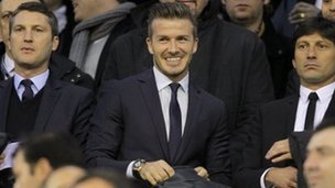 David Beckham (centre) watches his PSG side at Valencia