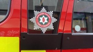 Woman rescued by Belfast fire crews