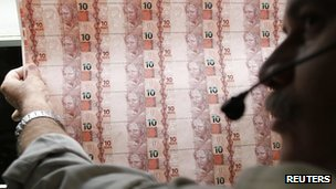 Brazilian Mint worker checks sheet of 10-real banknotes