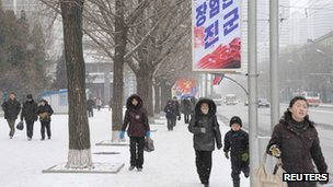 North Koreans walk on a street in Pyongyang, 12 February 2013, in this photo taken by Kyodo