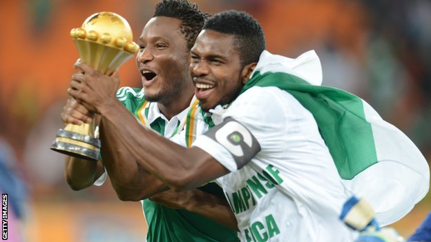 Nigerian players celebrate with the Nations Cup trophy