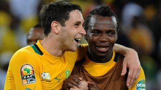 South African midfielder Dean Furman (L) celebrates his team&#039;s progression from the group stage