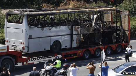 File photo of a truck carrying a bus damaged in a bomb blast outside Burgas airport in Bulgaria in July 2012