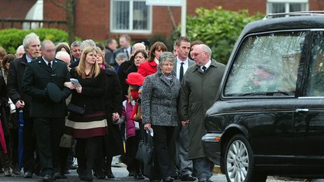 Mourners follow hearse
