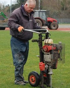 Footes Lane groundsman Shane Moon works on the pitch