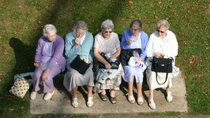 Older women having lunch on a bench