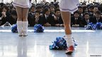 Japanese college students watch cheerleaders