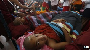Burnt Buddhist monks receive treatment at a hospital after police reportedly fired water cannon and gas in Monywa, November 2012