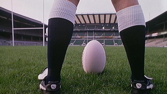 A rugby player and rugby ball
