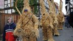 People dressed as straw bears 
