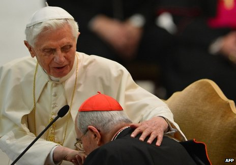 Cardinal of Rome Agostino Vallini (R) kisses the ring of Pope Benedict XVI during an audience at the Vatican, 14 February