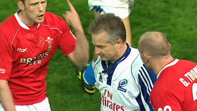 Chris White finds himself at the centre of attention as Welsh players argue over the early end to the match