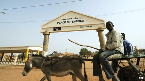 A donkey and cart by the entrance of Sharia Square in Gao, Mali - 31 January 2013 