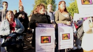 Disability protesters holding banners