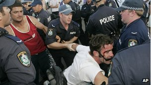 A man is arrested at Cronulla Beach in Sydney, Australia, Sunday, 11 December 2005