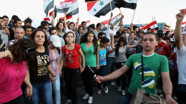 Pro-regime Syrians at a rally in Damascus