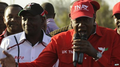 Uhuru Kenyatta (right), addresses supporters beside running mate William Ruto during a political rally in Nairobi on 13 February 2013 