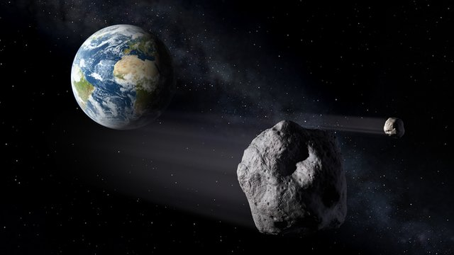 ESA artist&#039;s conception of asteroids and Earth