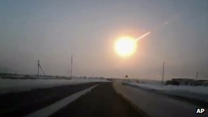A still from dashboard video recorded in neighbouring Kazakhstan shows the meteor which hit Russia, 15 February