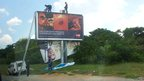 A poster featuring Pistorius is removed from a roadside in Johannesburg
