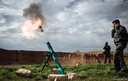 Syrian rebels fire a mortar