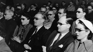 Cinema-goers wearing 3D glasses at a special Festival of Britain three dimensional film screening.