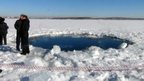 A 6m (20ft) hole in the ice of a frozen lake outside the town of Chebakul in the Chelyabinsk region, 15 Feb.