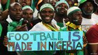 "Nigeria football fans with a sign ""Football is made in Nigeria"" at the Africa Nations Cup final in Johannesburg, South Africa - Sunday 10 February 2013"