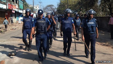 Bangladeshi police patrol on the street after clashes with Jamaat-e-Islami activists in Cox&#039;s Bazar