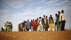 Bus passengers line up to be searched outside Gao, Mali - Tuesday 12 February